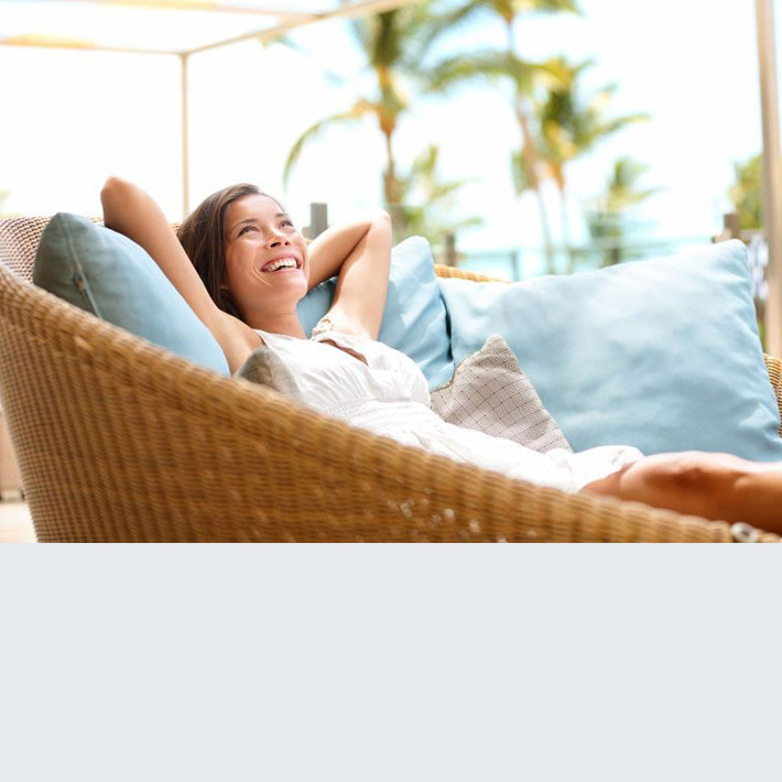 Woman relaxed and happy on couch outdoors