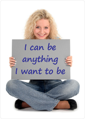 Woman holding sign saying I can be anything I want to be