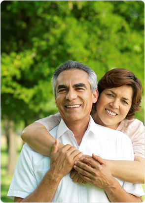 Happy mature couple holding each other portrait