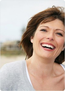 Woman happy and smiling on the beach